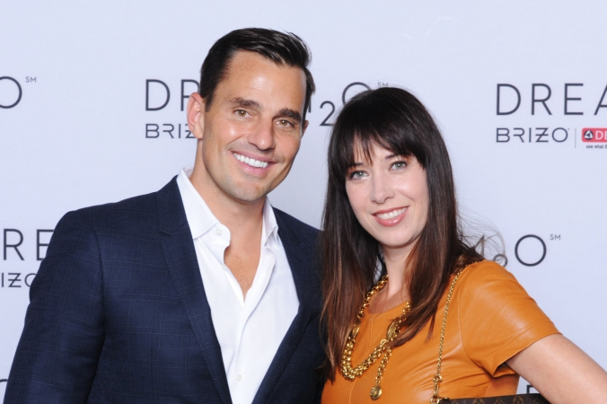 reality tv star bill rancic poses with guest, step repeat celebrity photography with 5x7 onsite photo printing, private corporate event, merchandise mart, chicago, event photography by fab photo