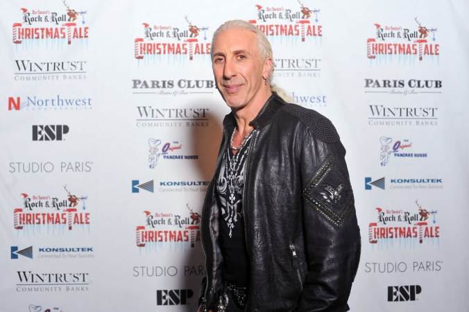 rock legend Dee snider poses on the step and repeat at the after party for his rock n roll christmas tale, studio paris, chicago