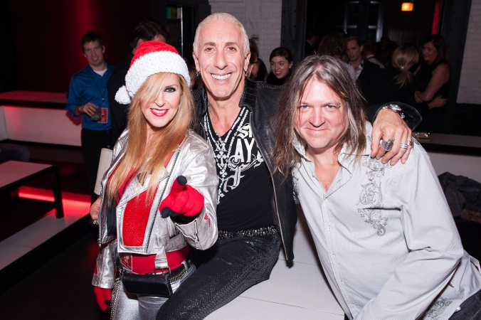 Lita Ford, Dee Snider, and Ace pose at Studio Paris, Chicago, after party  for Dee Snider's Rock Christmas Tale