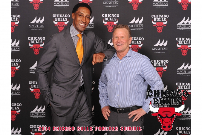 chicago bulls nba legend scottie pippen poses on step repeat with a fan who gets 8x10 photo souvenir printed instantly onsite