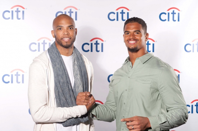 sports celebrities taj gibson and corey wootton pose on step and repeat at private corporate event downtown chicago, photography by fab photo