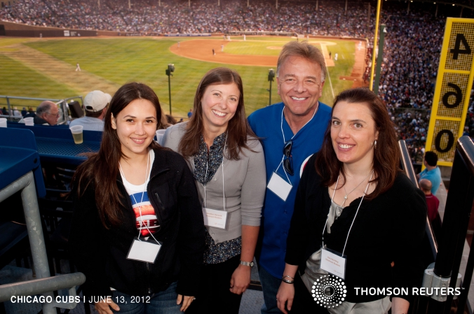 Group photo at Thomson Reuters private Cubs rooftop event.