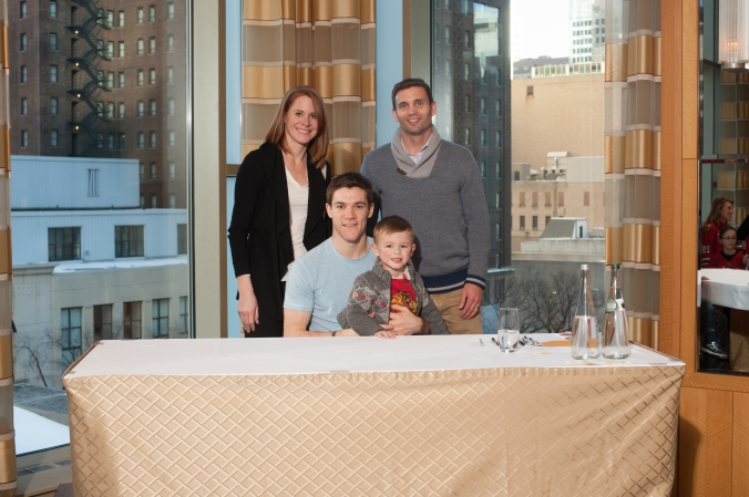 sports celebrity photo of family meet and greet with chicago blackhawks andrew shaw.