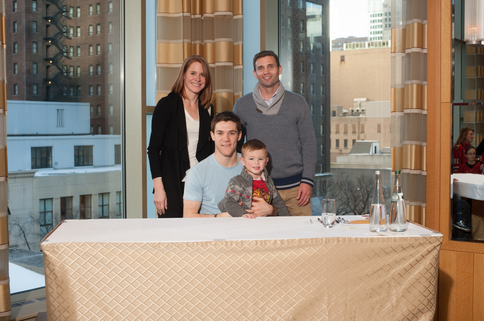 Corporate event photography chicago corporate event photographer sports celebrity photo of family meet and greet with chicago blackhawks andrew shaw m4hsunfo
