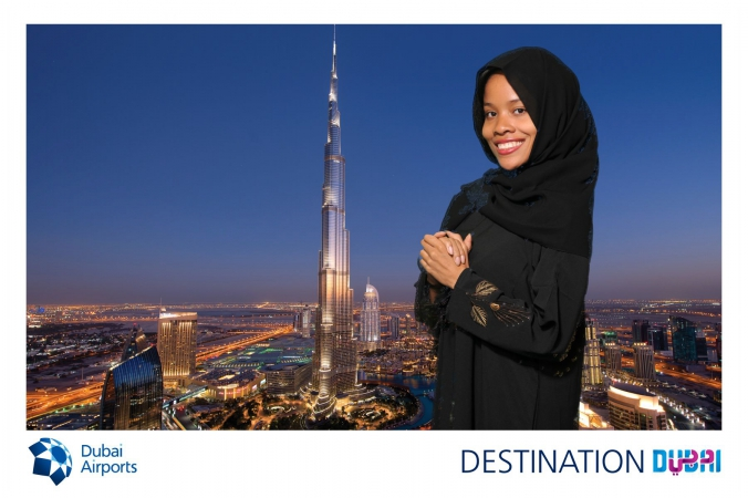 woman poses with dubai tallest building in the world, burj khalifa, dubai, made possible with green screen tradeshow photography, fab photo chicago