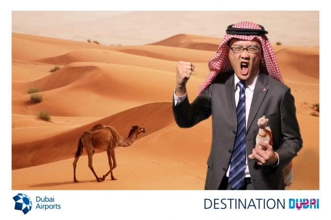screaming asian man holds camel doll in desert, photo postcard, dubai airports, world routes mccormick place chicago 2014,