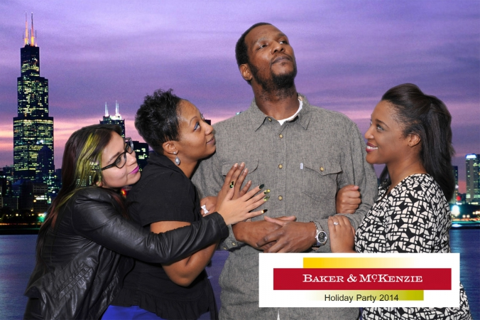 ladies man poses heroically on chicago skyline background, green screen photography by fab photo chicago at baker mckenzie holiday party