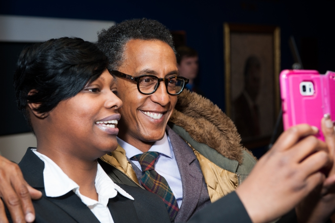 HBO star Andre Royo, Bubbles from The Wire, poses with fan at Mavis! documentary premiere, Chicago DuSable Museum African American History
