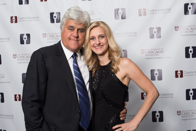 Jay Leno poses with fan for a step and repeat photo, GIRF Ball annual fundraising gala