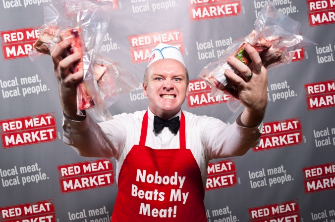 Nobody beats my meat! Step and repeat photo at the Red Meat Market launch party