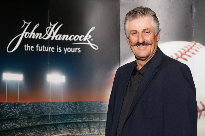 Celebrity baseball pitcher Rollie Fingers appears on behalf John Hancock, tradeshow photobooth with onsite printing.