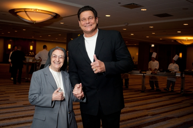 Chicago Bears star Dan Hampton poses with nun half his size at the Presence Ball, event photography by fab photo