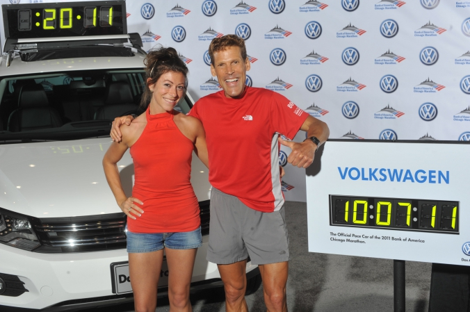 ultra marathon man dean karnazes poses with fan and official pace car volkswagen tiguan chicago marathon 2011, photo printed instanly onsite