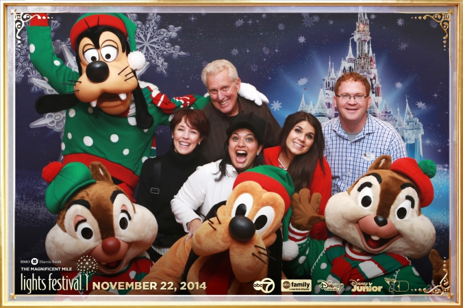 disney characters goofy pluto chip and dale pose with guests at chicago abc7 corporate event festvial of lights
