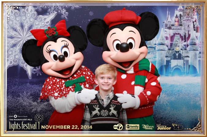 mickey and minnie mouse pose for onsite instant photo print at festival of lights event, chicago