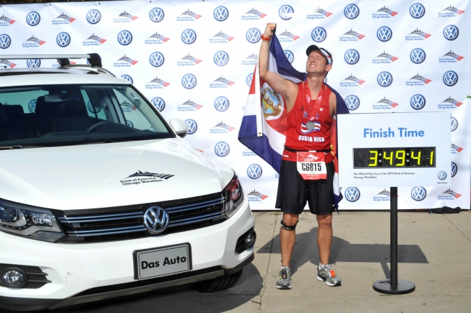 costa rican runner celebrates end of chicago marathon with onsite photo prints sponsored by vw and bank of america