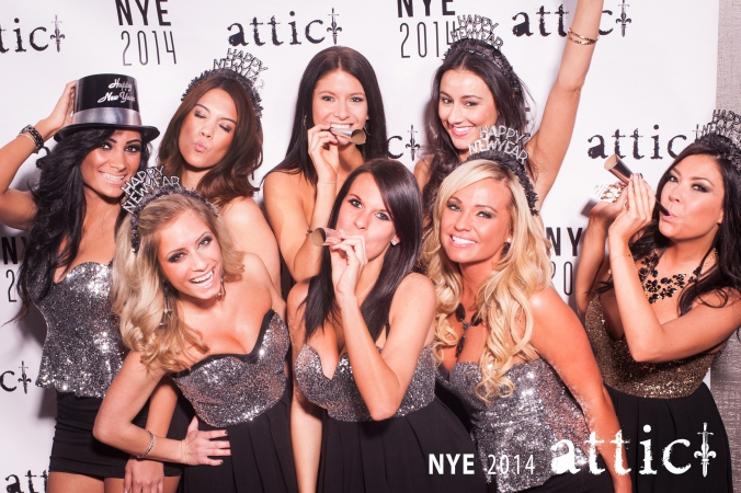 beautiful hostesses pose on step and repeat for party photography at attic nightclub downtown chicago, new years eve