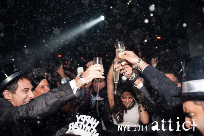 party photo, guests celebrating midnight toast new years eve at attic downtown chicago night club