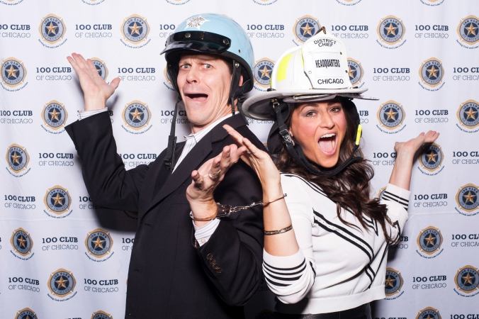 dan merlo and meredith ahern handcuffed on step repeat background, 100 club fundraising event, studio paris chicago