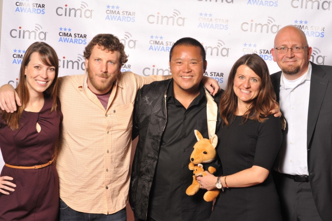danny huynh poses for group photo on step repeat, cima star awards
