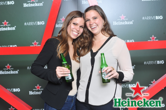 cute girls pose with new heineken bottles, step repeat photography at product launch event, chicago