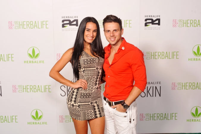 handsome couple pose for step repeat photography, union station chicago, herbalife conference