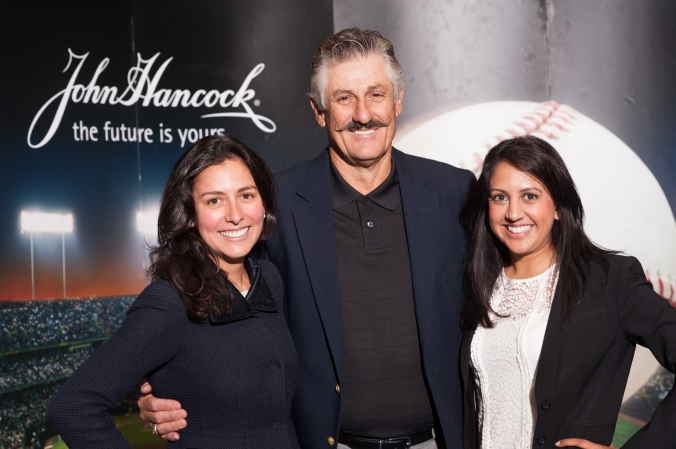 celebrity pitcher rollie fingers poses for photo with guests at john hancock booth, mccormick place chicago tradeshow