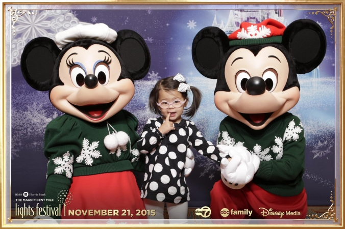 Mickey and Minnie pose with children at Disney and ABC Family sponsored step and repeat photography event, 2015 Festival of Lights, Chicago, Hotel Intercontinental