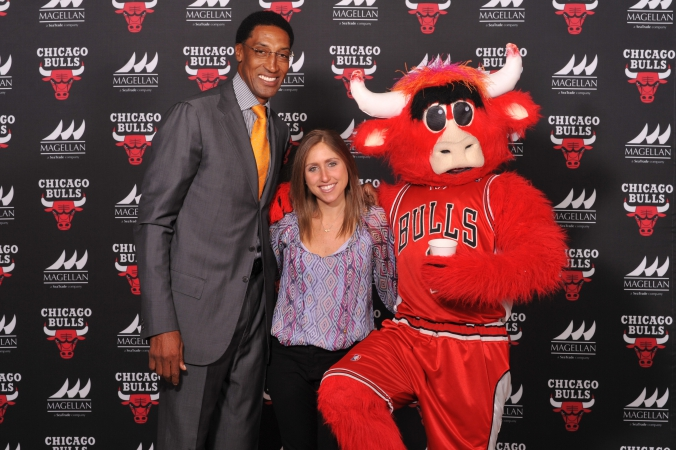 NBA legend Scottie Pippen poses on the step and repeat with benny the bull and lucky fan