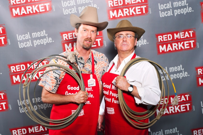 red meat market owner pose for step repeat photo at chicago launch party