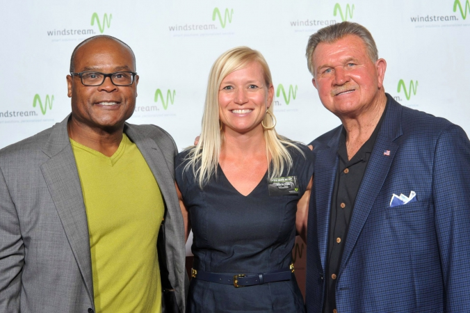windstream corporation recruits chicago football legends mike singletary and coach ditka to pose with guests on step repeat photography at their event