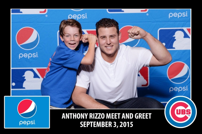 MBL All Star Anthony Rizzo poses with child at FAB Photos step and repeat photo booth.