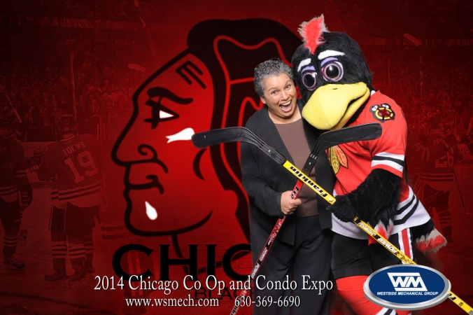 blackhawk mascot tommy hawk poses with fan at green screen tradeshow photobooth, navy pier, chicago co op and condo expo