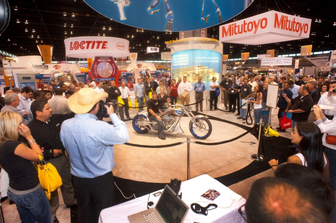 Faro increases its tradeshow booth traffic with celebrity appearance of Paul Jr from Oragne County Choppers, photos printed onsite, quality expo, mccormick place